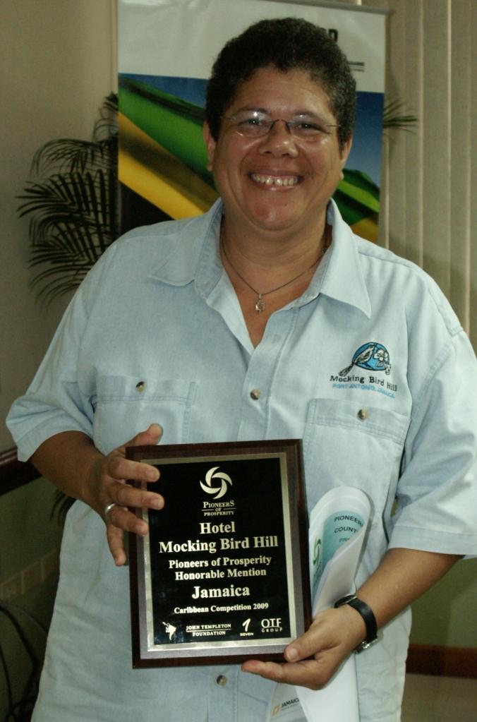 "Barbara displays her Pioneer of Prosperity ""Honourable Mention"" Award!"