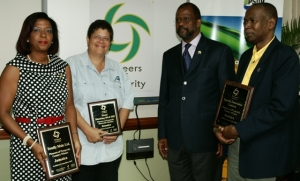 PIONEERS OF PROSPERITY (L-R): Sandra Samuels, CEO, TotallyMale ClubSpa Salon, Barbara Walker of Hotel Mocking Bird Hill), and Silburn Clarke, President/CEO, Spatial Innovision.  At 2nd. right is Robert Gregory, President of Jamaica Trade & Invest.