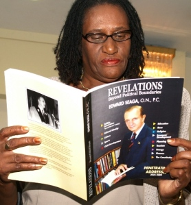 Dr. Maria Smith skimming through her copy of REVELATIONS
