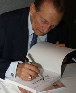 Edeard Seaga, Former Prime Minister of Jamaica, signs one of his two books, REVELATIONS (Beyond Political Boundaries)!